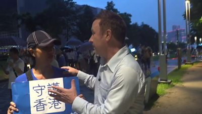 Stephen McDonell and protester