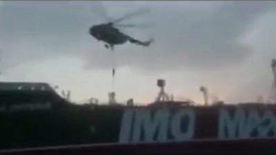 A helicopter hovering above what appears to be the Stena Impero