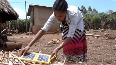 Girls with solar lamp