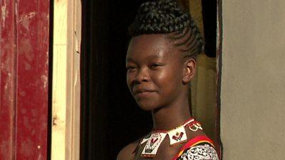 Sandizile Malindiza standing in a doorway