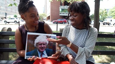 Two Americans looking at a photo of Boris Johnson