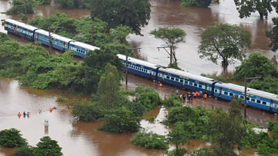 Hundreds of passengers had to be helped from a train near Mumbai.