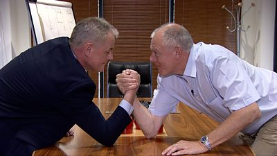 Simon Evans and Marc Bailey arm wrestling