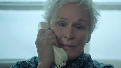 Actress Glenn Close speaks into a telephone in a scene from The Wife