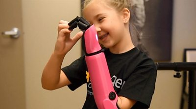 Eight-year-old Mady, the youngest recipient of a bionic arm in the US, requested it be bright pink.