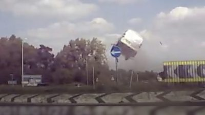 'Flying' van on A11 roundabout