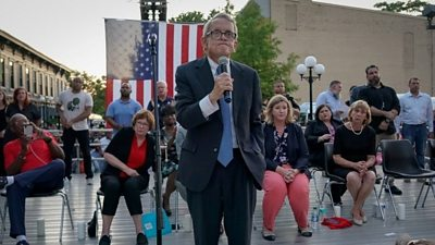 Mourners at a vigil for the victims of the mass shooting in Dayton, Ohio, demand action from politicians.