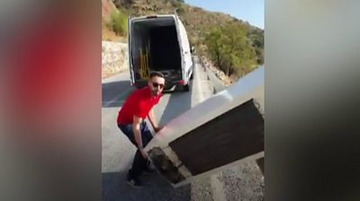Man forced to collect fridge from the bottom of a cliff