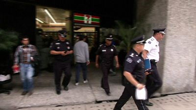Police leave the scene of the raid
