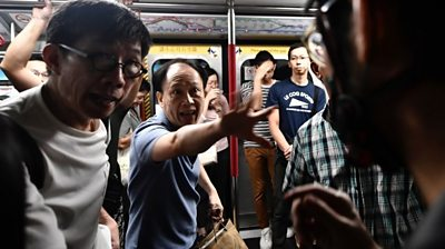 Angry commuters scuffle with HK protesters