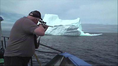 Man shooting iceberg