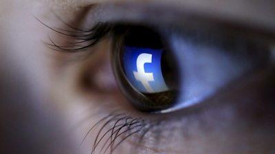 Facebook logo on eye