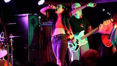 Woman singing at a punk rock concert