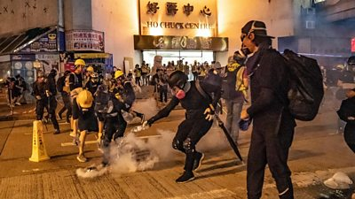 Police fired tear gas across downtown Hong Kong on Sunday night