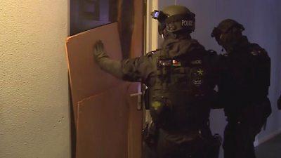 Police banging on door