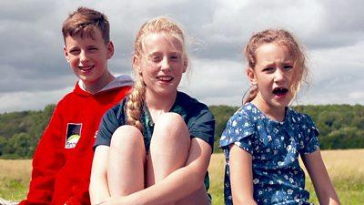children-sat-on-hay.