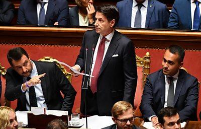 Italy's PM Giuseppe Conte addresses Senate flanked by Matteo Salvini (L) and Luigi Di Maio (R)