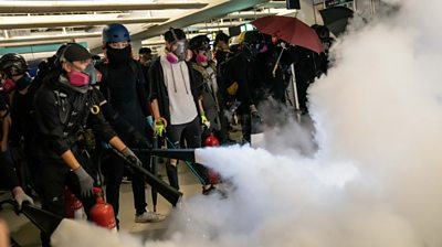 HK protesters letting off fire extinguishers
