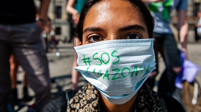 Woman in Amsterdam wears facemask with #SOSAmazonia on it