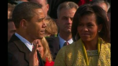 President Obama taking the oath as Michelle Obama stands by his side, on 20 January 2009