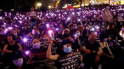 Protesters carry placards in Hong Kong