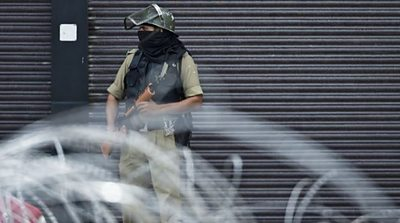 A security personnel stands guard on a street in Srinagar on August 28, 2019