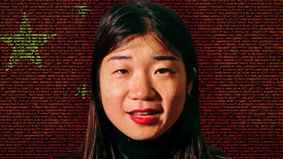 Journalist Karoline Kan against the backdrop of a Chinese flag made of computer code.