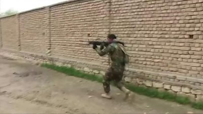 A member of the Afghan security forces fights Taliban militants in Kunduz