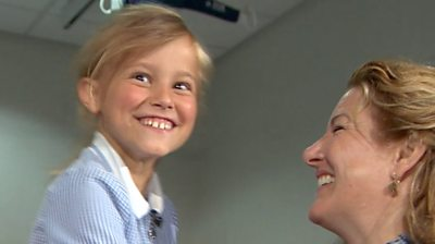 Eight-year-old Naomi with doctor