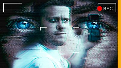 Connor holding a phone in front of a pair of eyes in the background