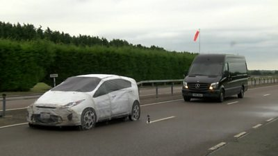 Dummy car hit by van