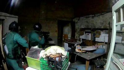Police raided houses at dawn