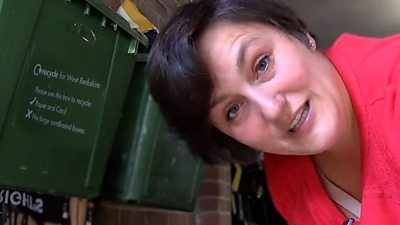 Janna Little inside the garage where she recycles her community's rubbish.