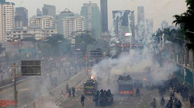 Tear gas outside Indonesia parliament on 24 September 2019