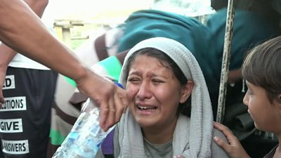 A woman at Greece's Moria refugee camp cries after police fired tear gas