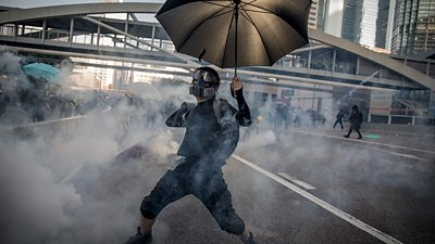 Protesters clash with police on the streets of Hong Kong