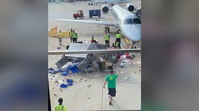 A worker had to intervene after a catering truck lost control at O'Hare International airport in Chicago.