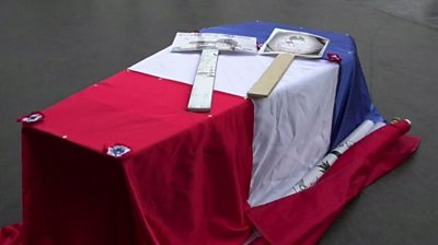 Police in Paris use mock coffins to protest against rising suicide rates