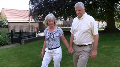 The couple holding hands