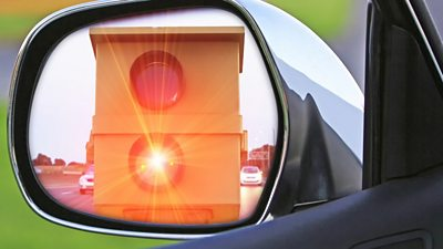 speed camera flashing in rear view mirror
