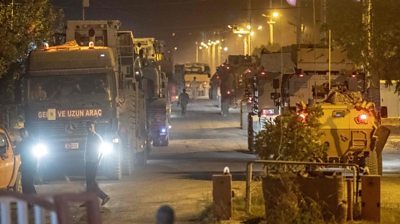 Turkish army soldiers drive towards the border with Syria near Akcakale in Sanliurfa province on 8 October