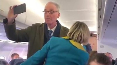 Protester on the plane