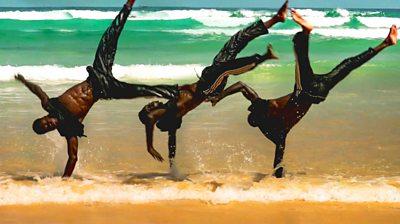 Breakdancer on a beach in Senegal