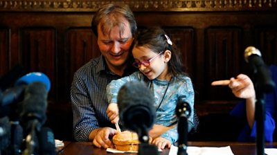 """Nazanin's daughter cuts a """"welcome home"""" cake with her dad"""