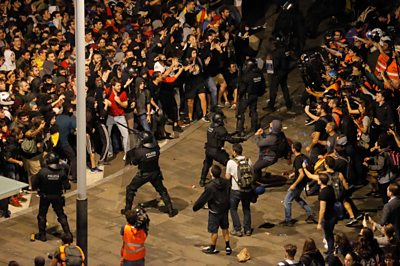 Police and protesters at El Prat Airport