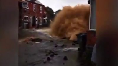 Burst pipe's water gushes high into the air