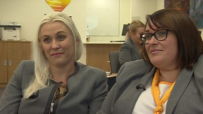 Former Thomas Cook staff go back to work in their travel shops.