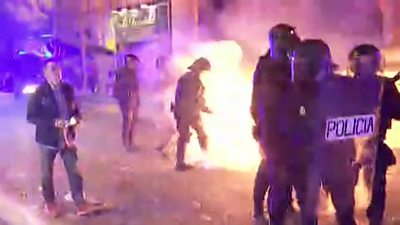 A petrol bomb is thrown at police