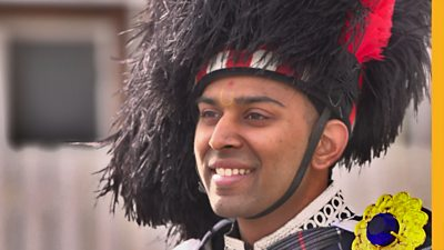 For Darshil, playing the bagpipes is the perfect way to honour the teachings of his Hindu guru. He leads the pipe band through the streets of North-West England.