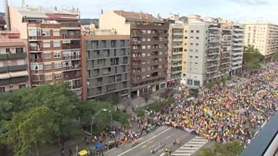 Demonstrators march down a main road in Barcelona on the fifth day of protests